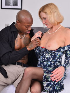 Busty mature woman Molly Maracas goes interracial
