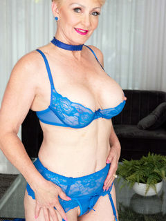 Busty granny Seka Black spreading in blue nylons